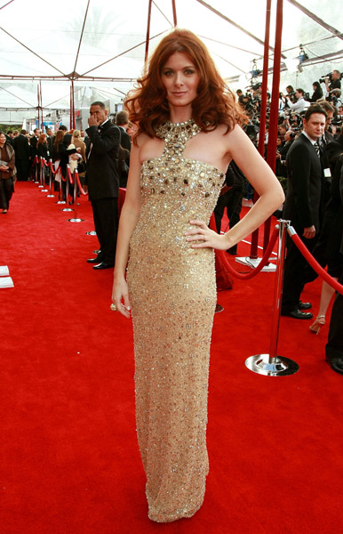 Debra Messing worked a gold column dress and dramatic neckline in 2008.