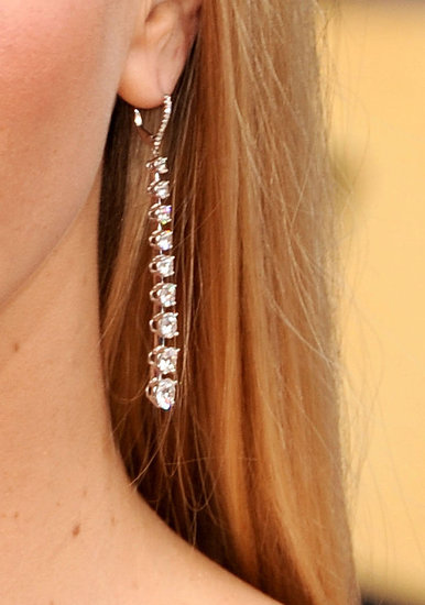 Her dangly Martin Katz diamond earrings were simple but elegant.