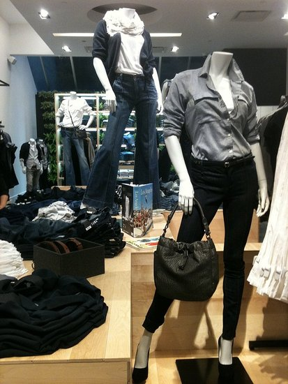 Inside the 1969 store with cute denim outfits on display.