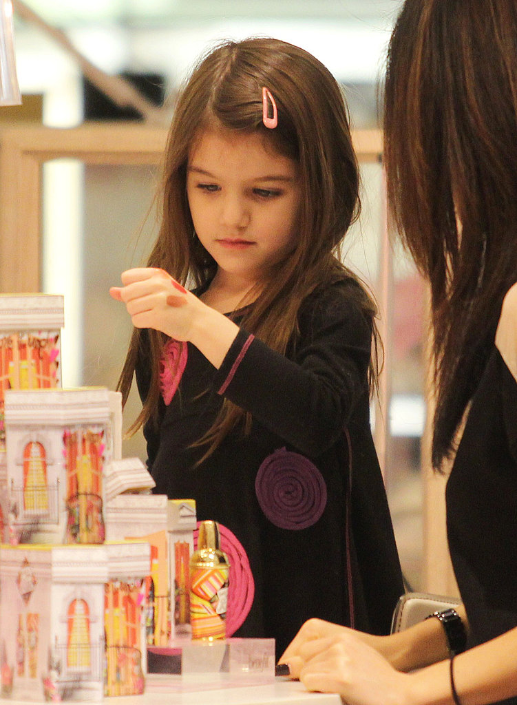 Pictures of Suri Cruise Trying on Lipstick in Vancouver
