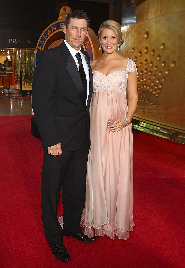 We love a well dressed bump! Kirsty Hussey and David Hussey made a stylish duo.