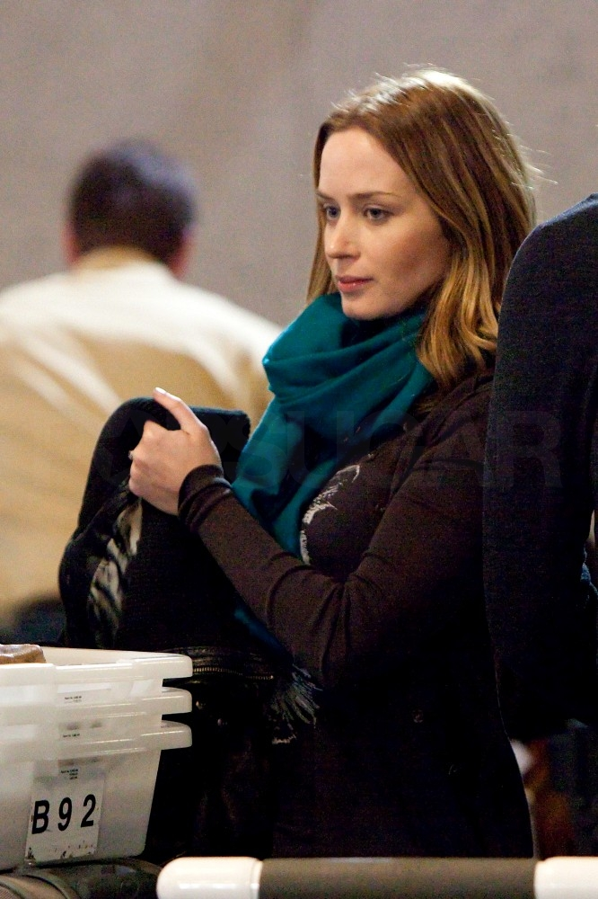 Emily Blunt Jets Off to Join Matt Damon With John Krasinski by Her Side