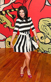 Jessica Szohr isn't wearing a pink dress, but she did pair pink peep-toe pumps with her striped look. Cute.