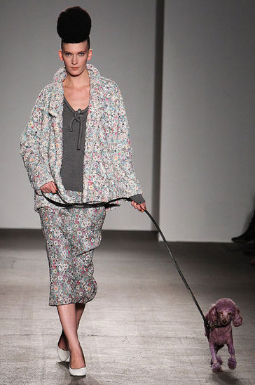 A tiny purple poodle struts his stuff at Isaac Mizrahi.