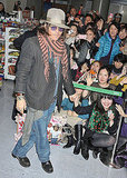 Johnny Depp Brings His Good Looks and Purple Sunglasses to Japan