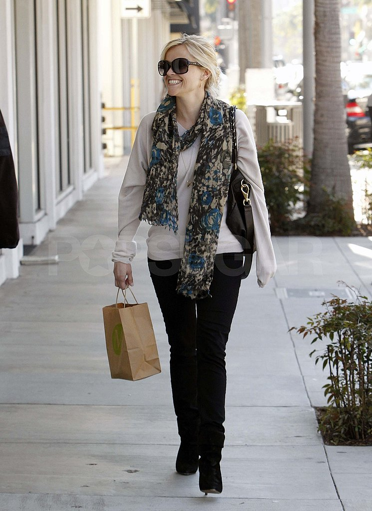 Reese Witherspoon Smiles and Shops in Style