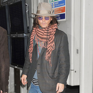 Pictures of Johnny Depp Arriving in Japan