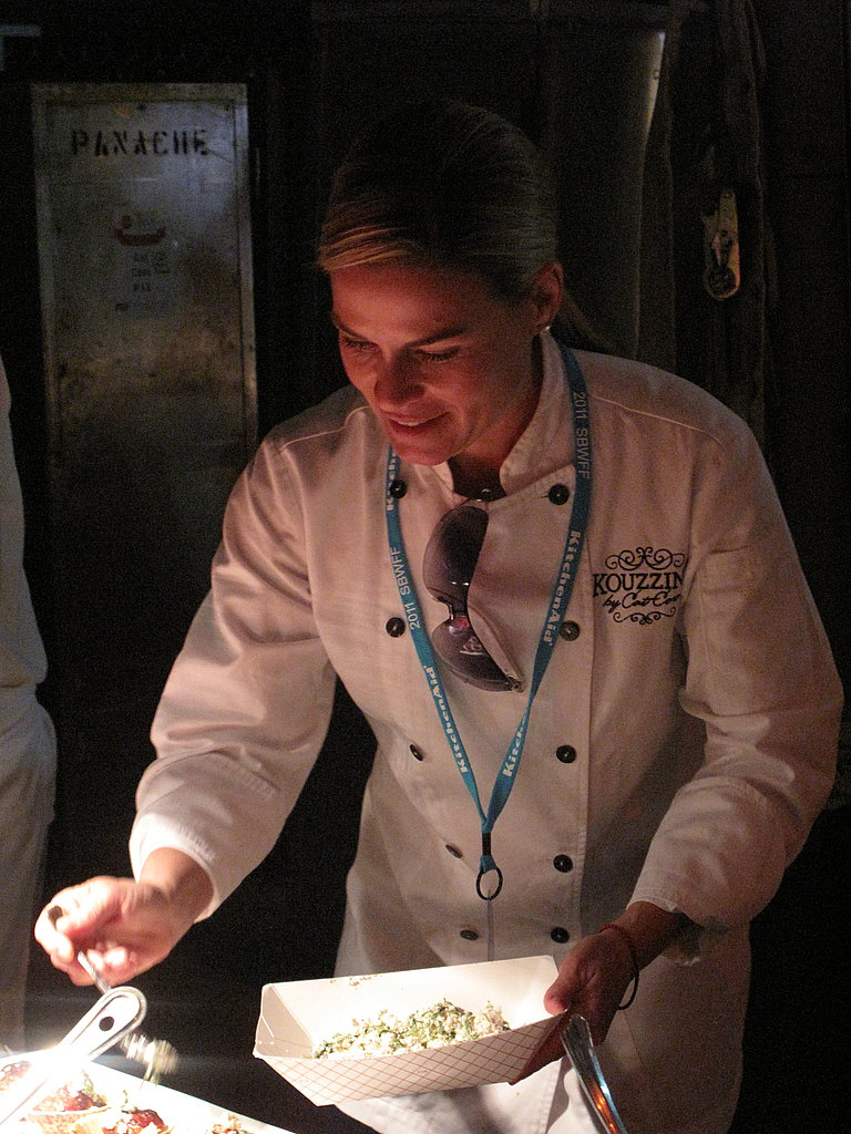 At the same event, Cat Cora was busy making sure her lamb soutzoukakia was finger-lickin' good.