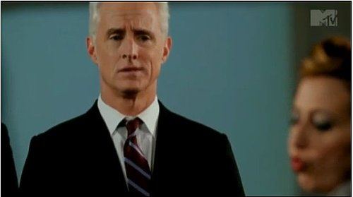 John Slattery Protects President Kristen Schaal in The National's New Video