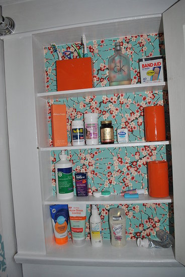 We lined the medicine cabinet with paper from Paper Source