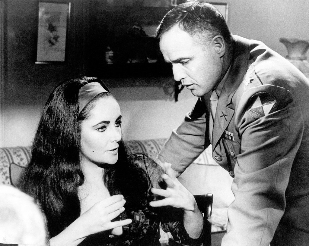 Elizabeth and Marlon Brando filming Reflections in a Golden Eye in 1967.