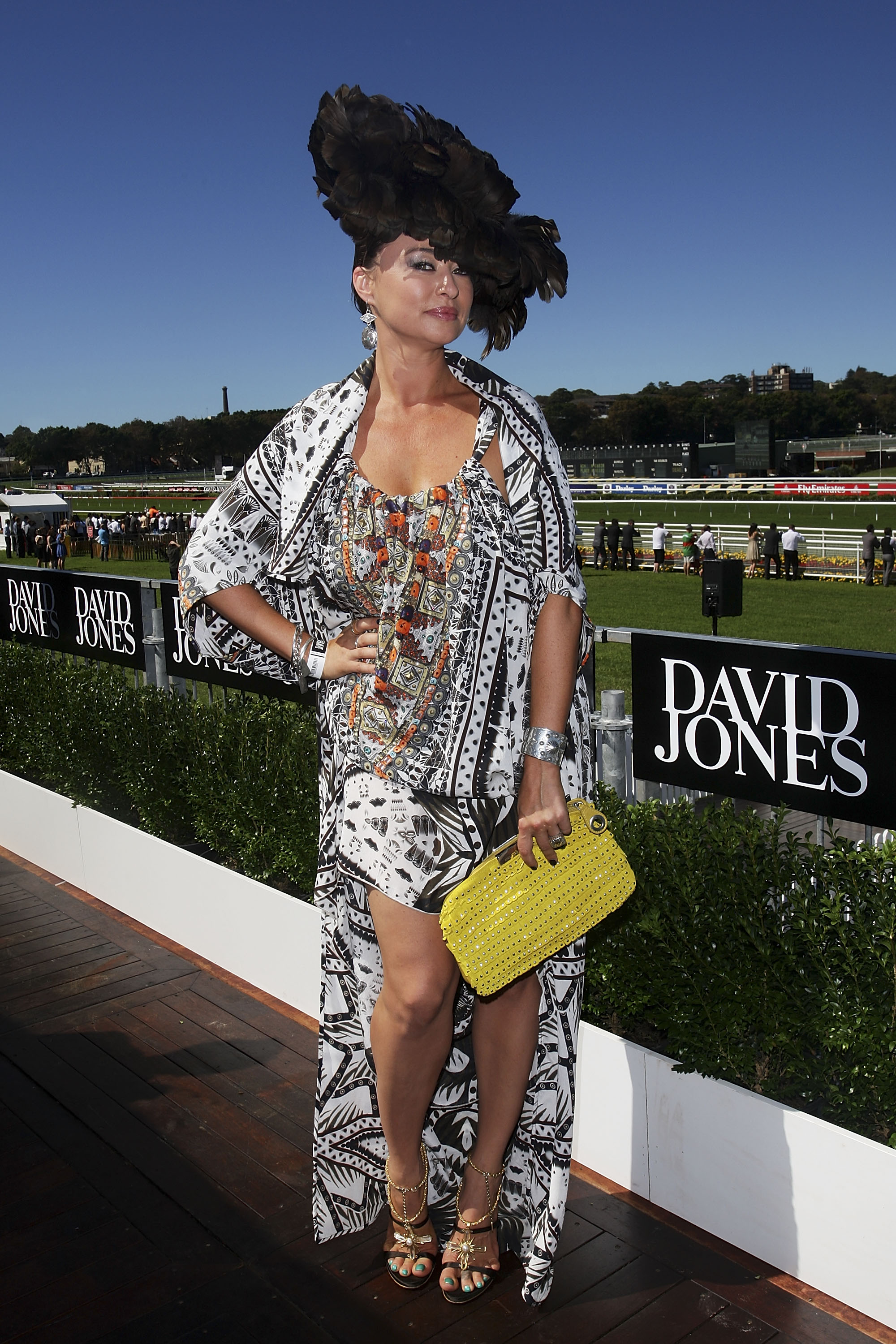 Kaftan queen Camilla Franks looked fab in a printastic dress and cape combo, topped off with a flamboyant featherd hat.