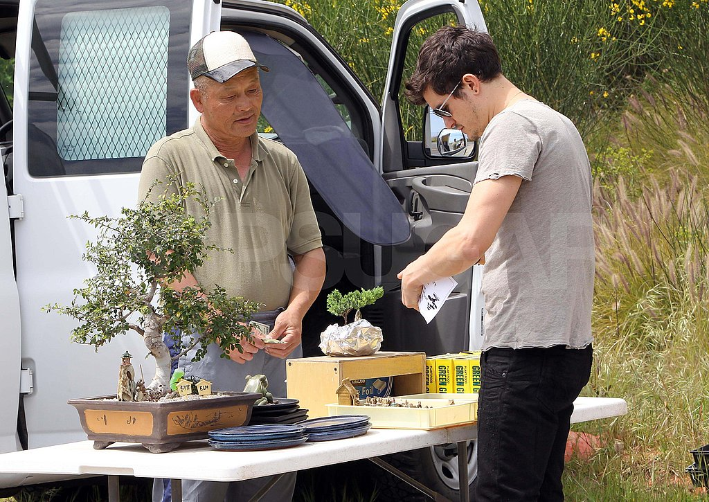 Orlando Bloom Picks Up a Baby Bonsai During a Day Out