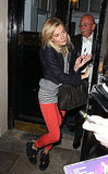 Sienna Miller mixed stripes, bright denim, and moccasin booties for the perfect downtown-cool vibe.