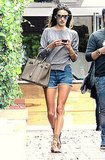 Alessandra Ambrosio stayed casual and completely chic, thanks to a slim-fit sweater and a great bag and sandals.
