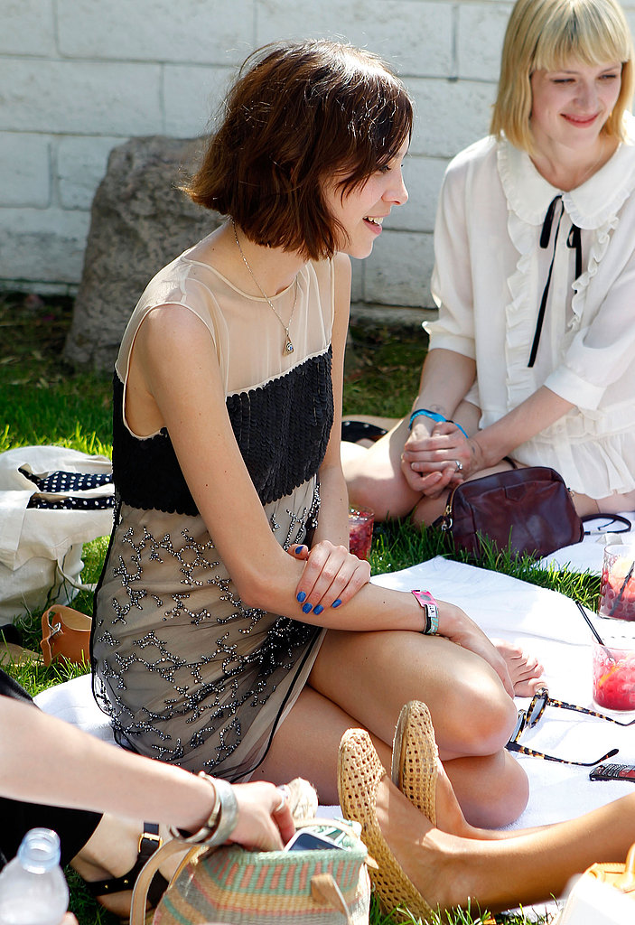 Alexa Chung stayed in the shade and chatted with friends at Mulberry's party.