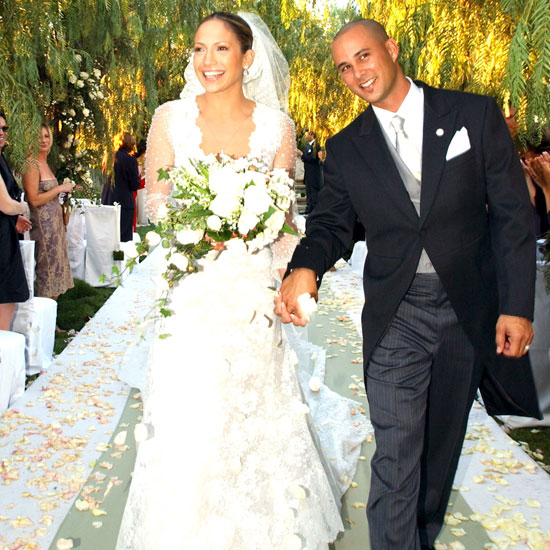 Jennifer Lopez and Chris Judd got hitched in Calabasas in September 2001. Jennifer wore a lovely lace Vera Wang gown for the outdoor affair.