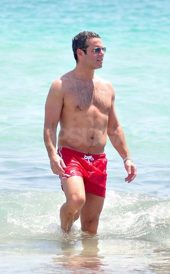 Bravo's Andy Cohen Goes Shirtless on the Beach Following a Grand Gay Pride Parade