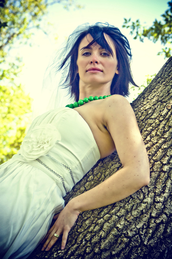Her strapless gown and kelly green necklace had vintage appeal, but this bride broke away from tradition and finished off her look with a totally tousled hairstyle.  Source: Flickr user Emery Co Photo