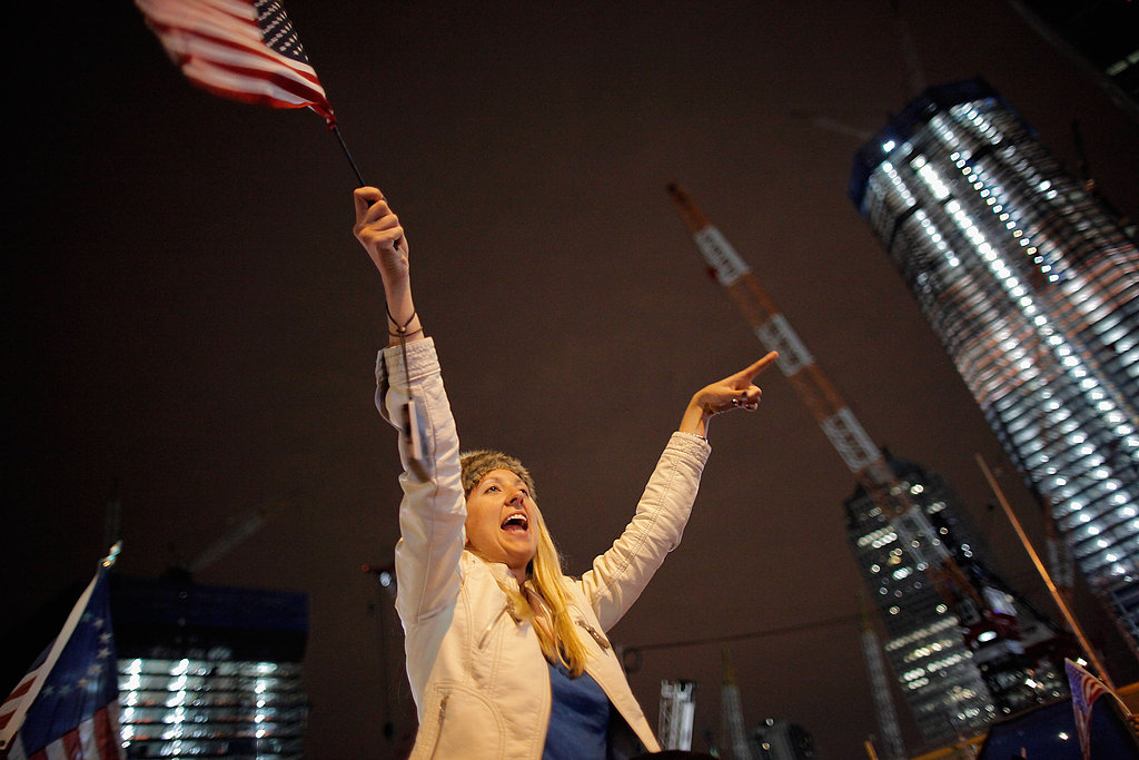 A woman in New York waves her flag.