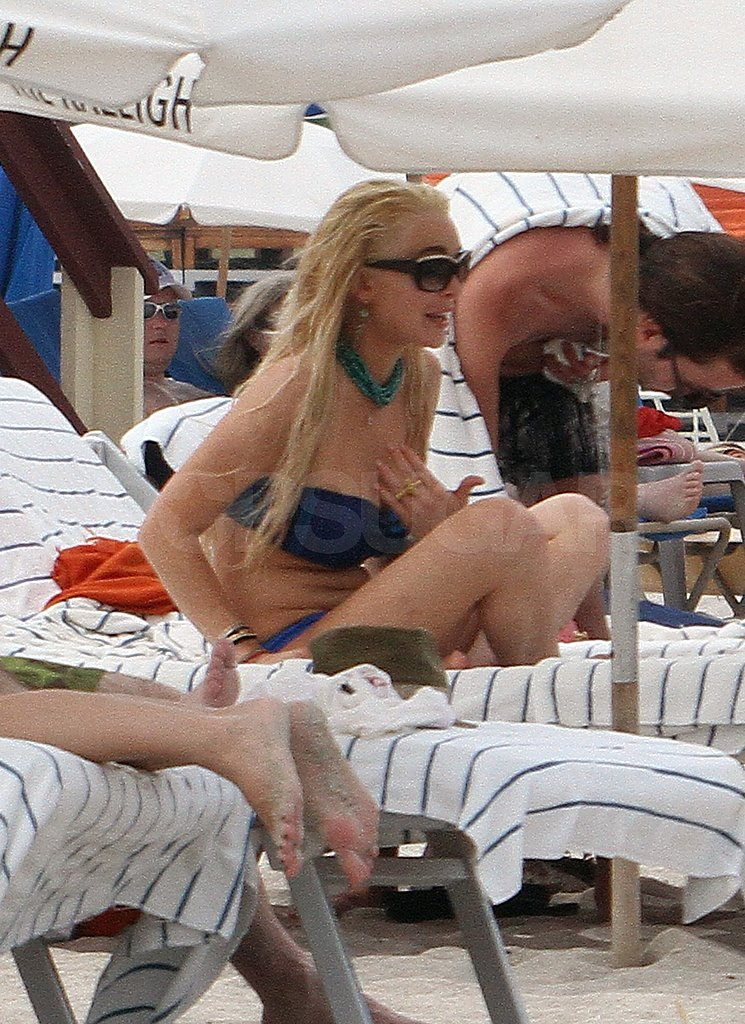 Lindsay Lohan Unwinds Between Photo Shoots With a Blue Bikini and Temporary Tattoo