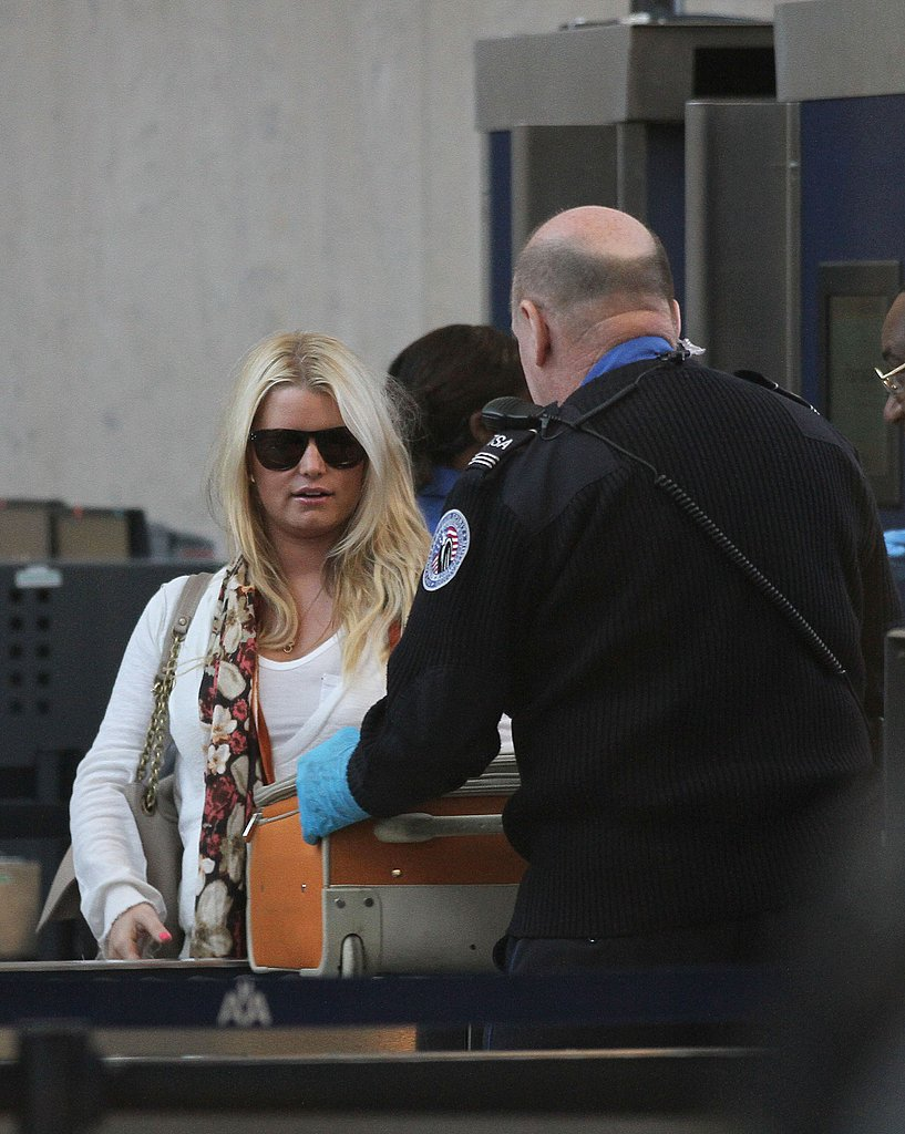 Jessica Simpson Makes a Stylish Solo Appearance at the Airport