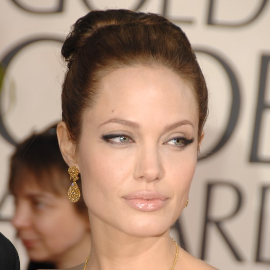Angelina channeled Cleopatra in 2007, wearing cat-eye liner, ultrapale lips, and a polished bun.