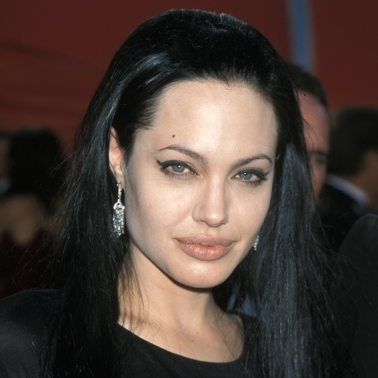 Angelina went long and dark for the 2000 Oscars, pairing the look with winged-out eyeliner and a light lip color.