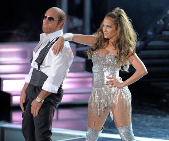Tom Cruise took the stage with Jennifer Lopez as his Tropic Thunder character Les Grossman in 2010.