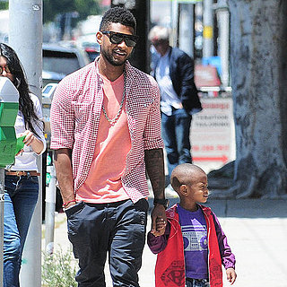 Usher Raymond and His Son Cinco Holding Hands in LA