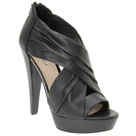 Softly gathered leather adds a romantic twist to black platform sandals.   Osmonda Heel in Black, $100