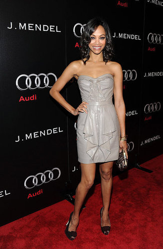 Zoe attended a party for J. Mendel wearing a silvery-gray strapless dress by the designer.