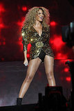 Beyonce Knowles showing legs on stage.