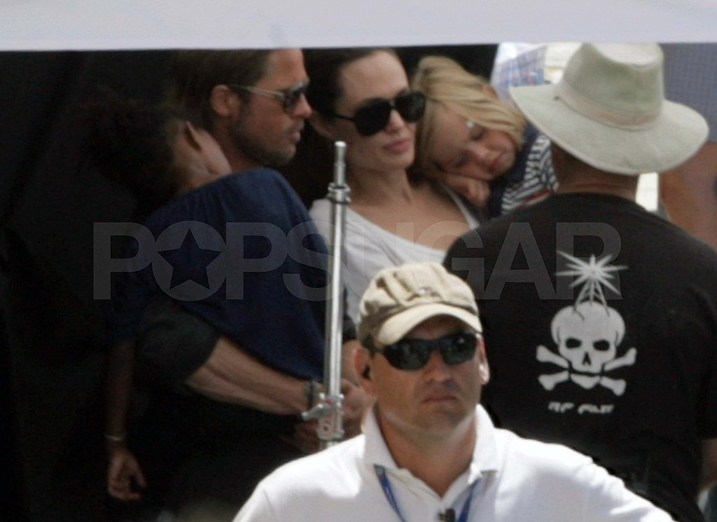 Shiloh and Zahara took a break in the shade with Brad Pitt and Angelina Jolie.