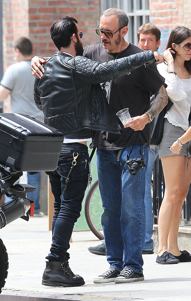 Justin Theroux and Terry Richardson hugged before parting ways.