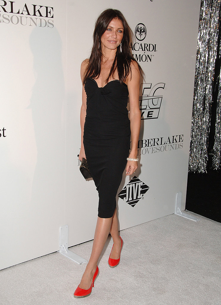 Spot-on sexy — and gorgeous as a brunette — in a strapless LBD and red pumps in 2006.