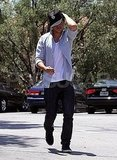 Zac Efron put his shirt back on heading to his car in LA.