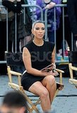 Kim Kardashian went for hoop earrings and a sleek ponytail on Project Runway's Battery Park set.