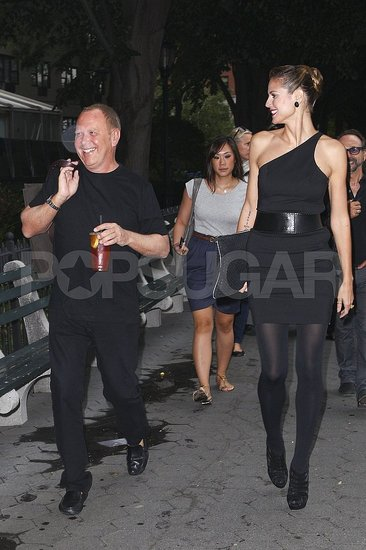 Heidi Klum and Michael Kors shared a laugh on set.