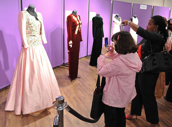 People admire the lilac Catherine Walker dress Diana wore for the state tour of India in 1992.