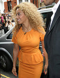 Beyoncé Knowles chose a bold, orange dress for her appearance with Piers Morgan.