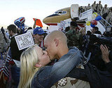 US Army soldier Ben Chane kisses his wife, Windy, upon returning in 2004 with other members of the Utah National Guard after a 14-month tour of duty in Iraq.