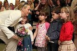 Charlene Wittstock is presented flowers from children during a visit to Ireland.