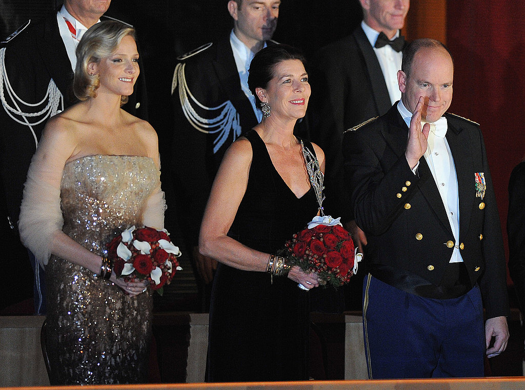 Charlene Wittstock, Princess Caroline of Hanover, and Prince Albert II of Monaco attend the Monaco National Day Gala concert.