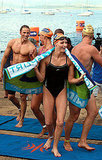 Wearing a swimsuit, Charlene Wittstock steps out of the water in South Africa.