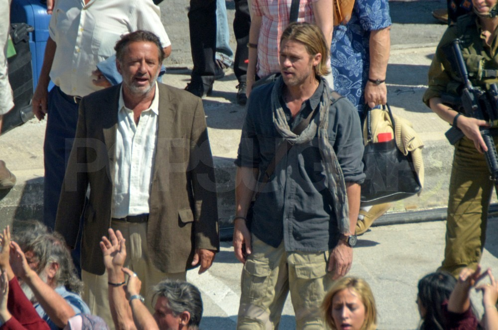 Brad Pitt was surrounded by dozens of extras on the set.