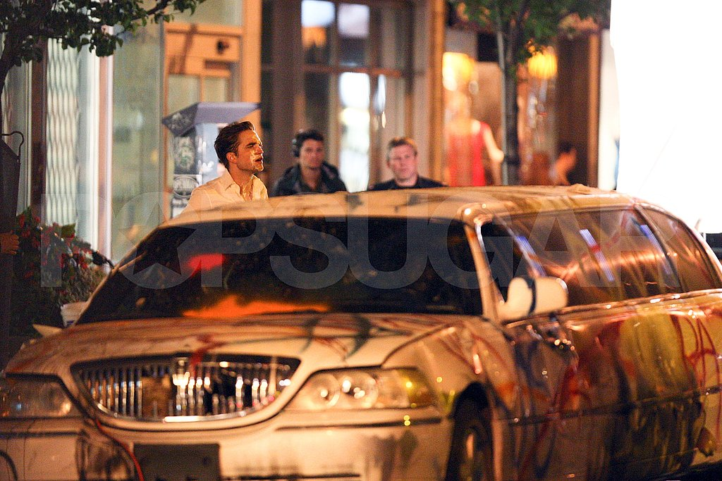 Robert Pattinson with a graffiti'd limo in Toronto.