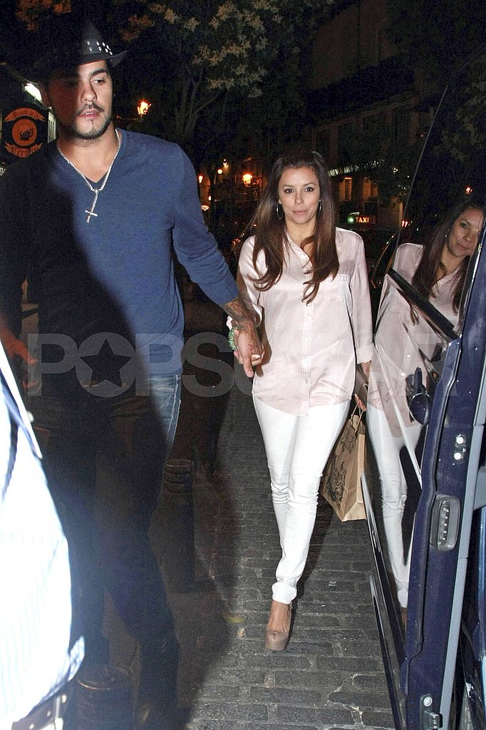 Eva Longoria and Eduardo Cruz held hands leaving dinner.