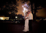 The happy couple stole a kiss during the fireworks at their Portland, OR, wedding. Photo by Jessica Hill Photography via Style Me Pretty