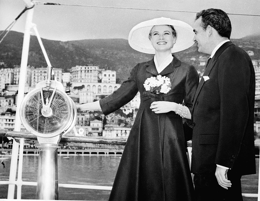 The couple are all smiles on the princely yacht in Monte Carlo's harbor, while Grace Kelly arrives from the US for their wedding ceremony. He took his yacht out to meet Grace's ship.